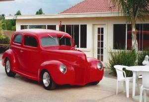 1940 Ford sedan featuring Progressive Automotive chassis